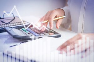 accountant calculating profit with financial analysis graphs 1 1