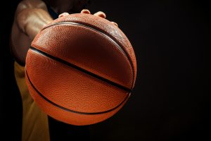 silhouette view of basketball player holding basket ball on black background 2